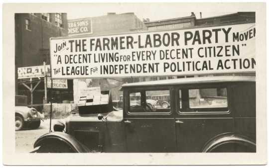 A Farmer-Labor political poster atop an automobile, ca. 1925.