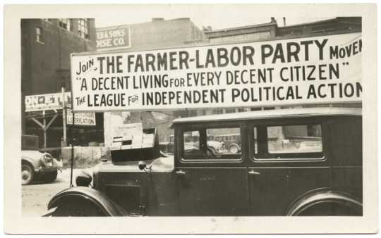 A Farmer-Labor political poster atop an automobile, ca. 1925.