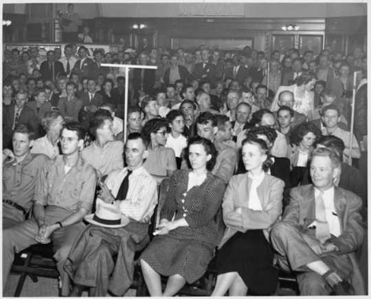 Black and white photograph of a Socialist Workers Party meeting, ca. 1940. Vincent R. Dunne and Grace Carlson sit in the center of the front row.