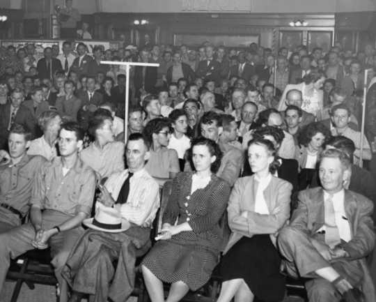 Black and white photograph of a Socialist Workers Party meeting, ca. 1940. Vincent R. Dunne and Grace Carlson in center.