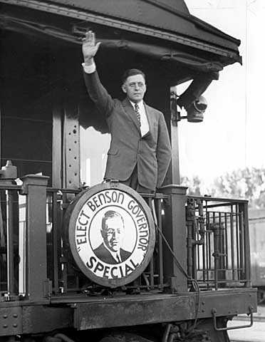 Black and white photograph of Elmer Benson waving from a campaign train, c.1936.