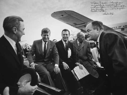 Black and white photograph of President John F. Kennedy at the Duluth airport with Senator Eugene McCarthy, Representative Donald Fraser, Governor Karl Rolvaag, and Senator Hubert H. Humphrey, 1965.