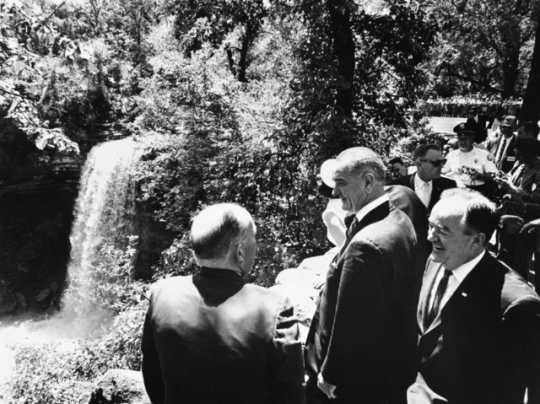 Black and white photograph of President Lyndon Johnson, Senator Hubert Humphrey, Governor Karl Rolvaag and party at Minnehaha Falls.