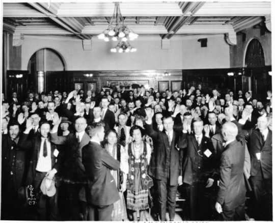 Immigrants taking oath of citizenship