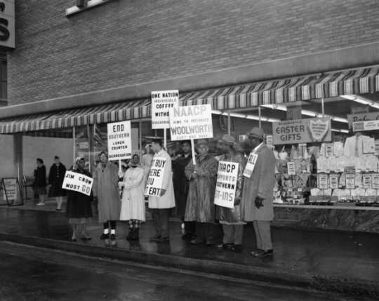 Black and white photograph of NAACP members picketing outside Woolworth's for integrated lunch counters, St. Paul, 1960.