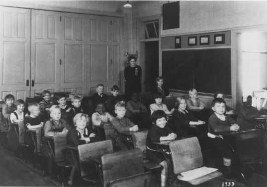 Photograph of John, Daniel, and Jessie Lyght in school