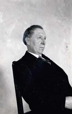 Black and white photograph of Joseph Gilbert seated, c.1925.