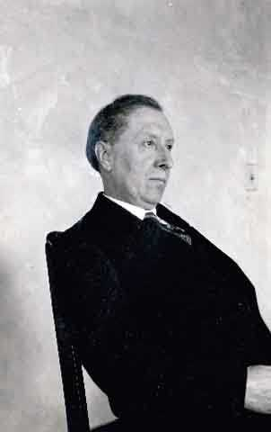 Black and white photograph of Joseph Gilbert seated, c.1925.