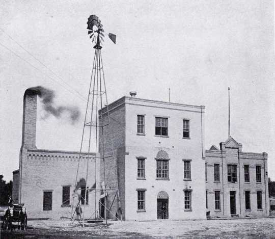 Black and white photograph of the buildings of the Kiewel Brewing Company in Crookston, ca. 1910s