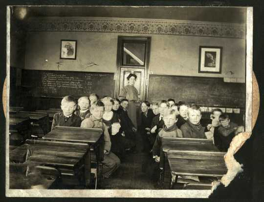 Photograph of students in Harmony's frame school, 1900