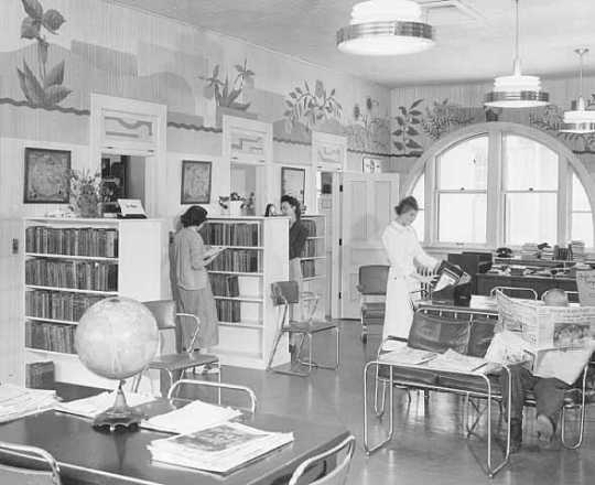 Black and white photograph of a library, at Rochester State Hospital, 1951.