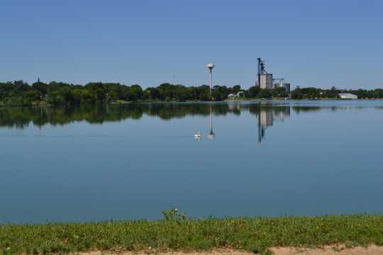Color image of Lake Wilson with grain elevator in background, 2016.
