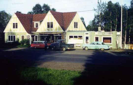 Color image of Lamb's Resort, ca. 1957, after the inn was connected to old gas station, facing south.