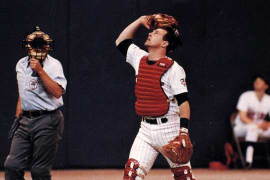 Twins' catcher Tim Laudner watches a foul ball fly out of reach, and into the Metrodome seats.