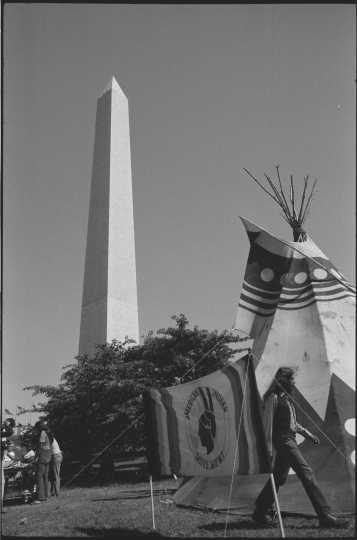 Tipi and AIM sign on the grounds of the Washington Monument