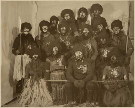 "Participants in the 1916 St. Paul Winter carnival pose in their ""Africa costumes."""