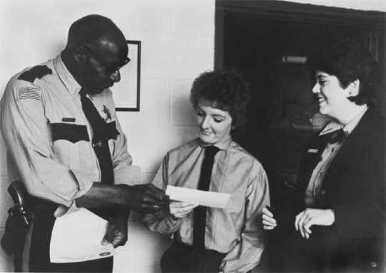 Photograph of John Lyght presenting a scholarship check