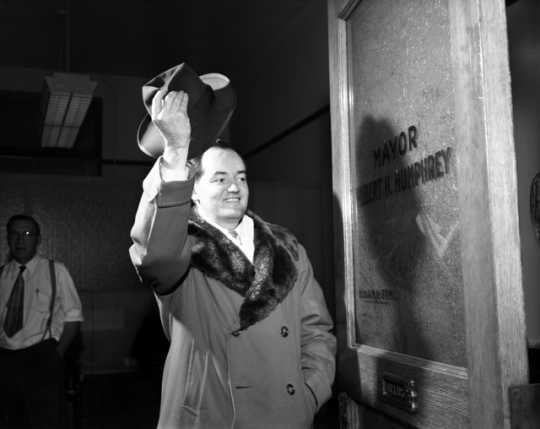 Black and white photograph of Hubert H. Humphrey says goodbye to the Minneapolis Mayor's office after winning a seat in the U.S. Senate, November 30, 1948.
