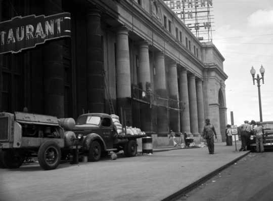 Black and white photograph of Workmen cleaning Minneapolis Great Northern Depot, 1944.
