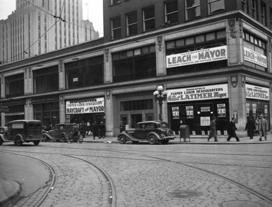 Black and white photograph of a Minneapolis street corner showing the Farmer-Labor Party headquarters, 1937.