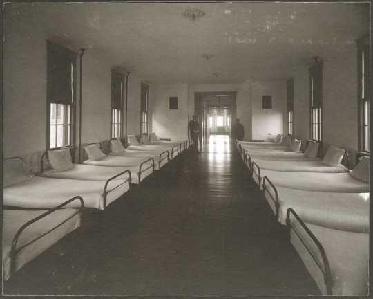 Interior view of a dormitory ward at the Anoka State Hospital, ca. 1910.