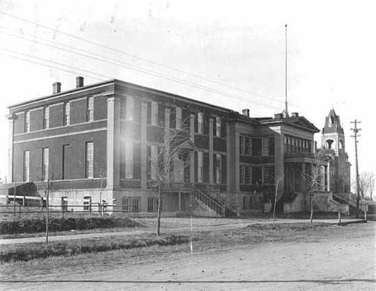 Black and white photograph of Turner Hall, 1895, site (outdoors) of the July 15, 1917, anti-draft rally.