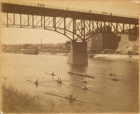 The Minnesota Boat Club racing on the Mississippi River, St. Paul, ca. 1890.