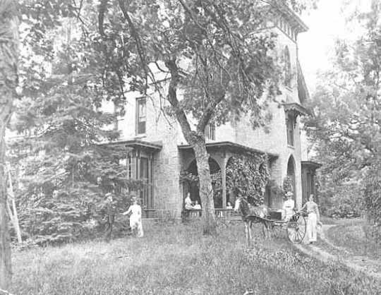 Members of the LeDuc family in front of their estate