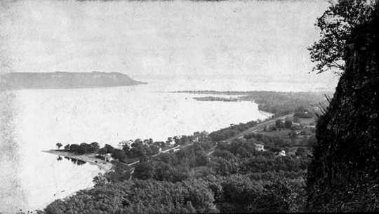 """Black and white photograph of Crag on """"Point-no-Point Bluff at Frontenac, c.1870."""