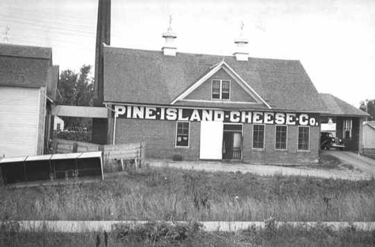 Black and white photograph of Pine Island Cheese Co., 1937.