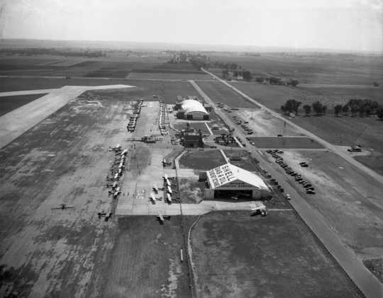 Black and white photograph of Northwest Airlines and McInnis Aviation Service hangars, Wold-Chamberlain Field, undated.