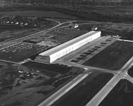 Black and white photograph of Northwest Orient Airlines hangar and offices at the Minneapolis-St. Paul International Airport, c.1960. Photographed by Marty Nordstrom Photography.