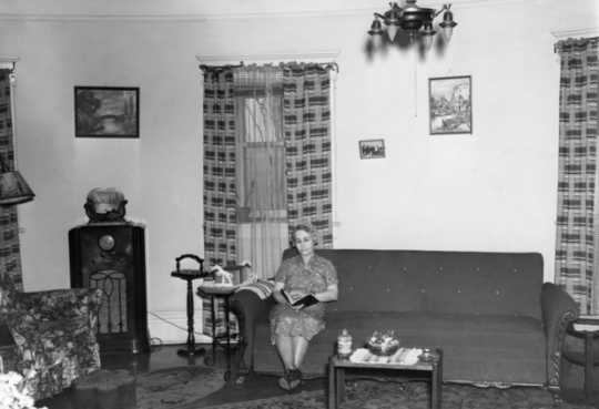 Black and white photograph of Mrs. Thomas Marcum, wife of the post's civilian electrical engineer, seated in her living room in the Round Tower, 1937.