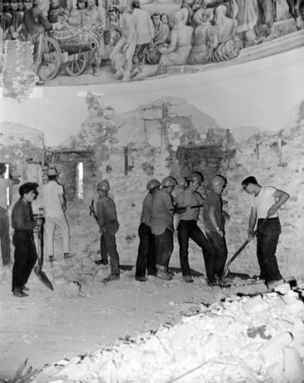 Black and white photograph of a crew excavating in the Round Tower at Fort Snelling in preparation for restoration, 1965. Photographed by Terry Garvey.