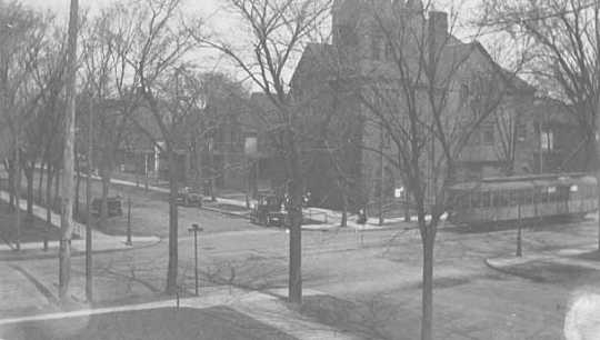 Black and white photograph of a street scene in the University District of Minneapolis, c.1920s.