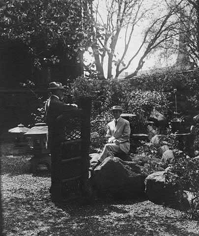 Black and white photograph of John S. Bradstreet and Sam Trubshaw (one of his designers) in the Crafthouse Japanese garden, ca. 1910.