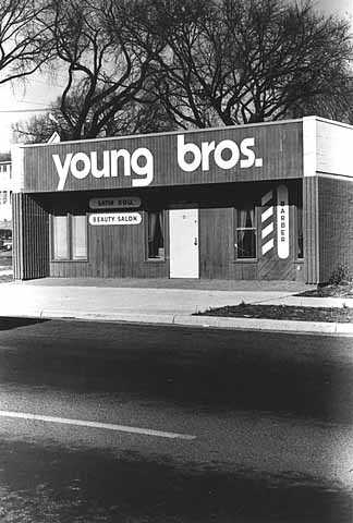 Young Brothers Barber Shop and Satin Doll Beauty Salon, 1918 Plymouth Avenue North, Minneapolis, ca. 1970s. The Young brothers owned multiple barber shops on Plymouth Avenue North.