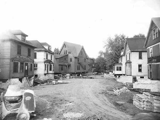 Black and white photograph of Houses being moved, undated.