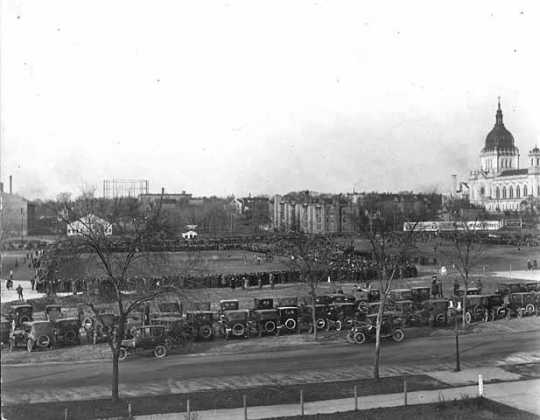 Black and white photograph of a crowd gathered for a football game at The Parade, 1923.