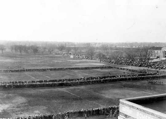Black and white photograph of fans lining the fields for football games at The Parade, about 1923.