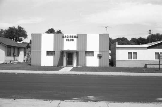 "Black and white photograph of the Nacirema Club (""America backwards), 1975."