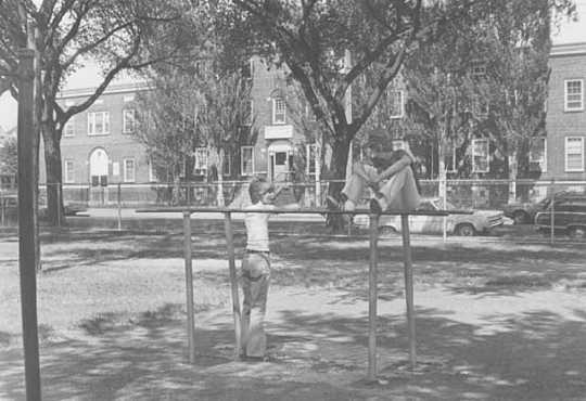 Black and white photograph of children in front of the Northeast Neighborhood House, 1976.