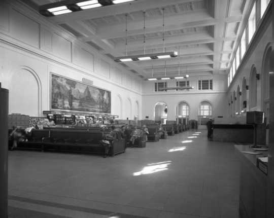 Black and white photograph of the interior of the Minneapolis Great Northern Depot waiting room, 1950.