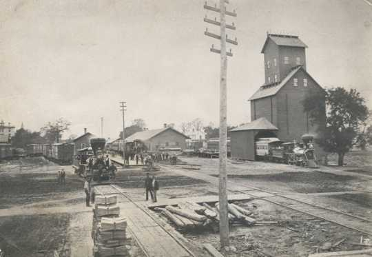 Black and white photograph of the St. Paul and Pacific Railroad depot, Washington Avenue and North Fourth Avenue, Minneapolis, 1874.