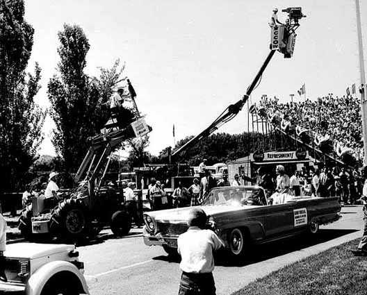 Black and white photograph of Aquatennial Parade Grand Marshal Richard M. Nixon departs Parade Stadium on the parade route, 1958.
