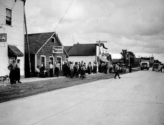 Striking lumberjacks standing near strike headquarters, Marenisco, Michigan.