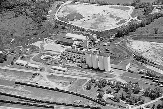 Black and white aerial view of the American Crystal Sugar factory in Chaska. Photographed by Vincent H. Mart in 1969.