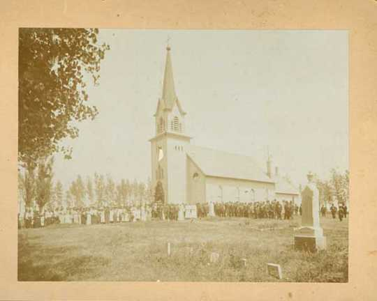 Congregation standing outside Swedish Lutheran Church in Svea Township