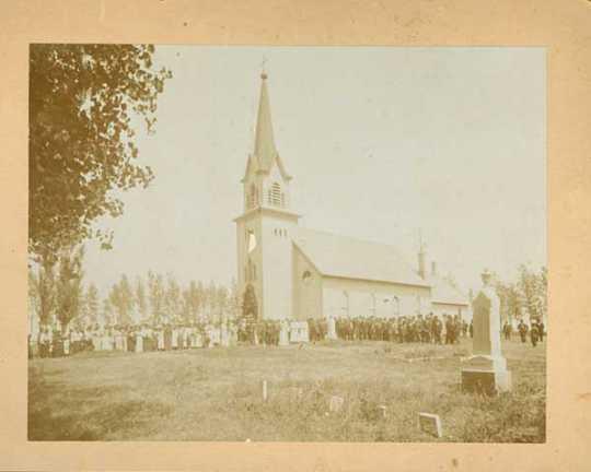 Congregation standing outside Swedish Lutheran Church in Svea Township