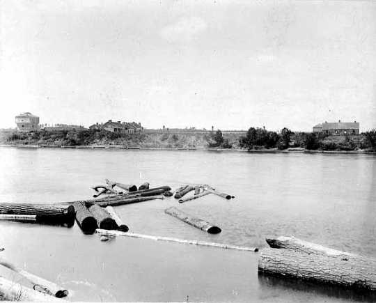 Black and white photograph of abandoned Fort Ripley as seen from the east side of the Mississippi River, c.1895.